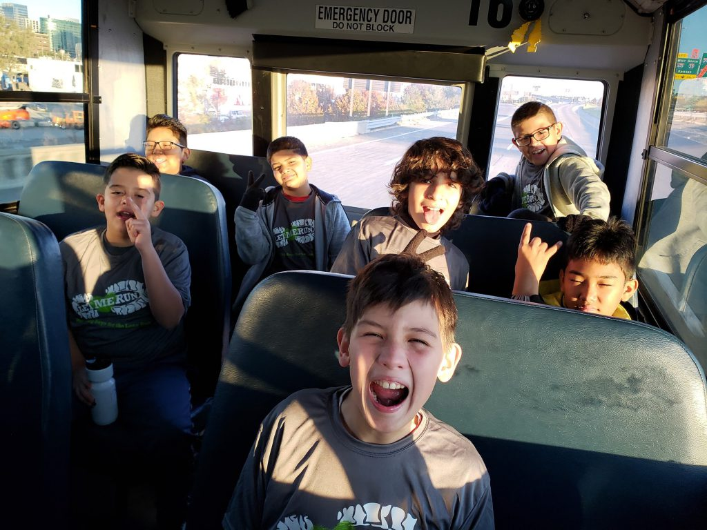 Boys on the bus on the way to Let Me Run 5K